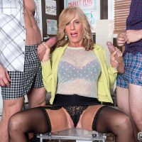 Over 60 blonde MILF Phoenix Skye blowing big cocks in MMF threesome