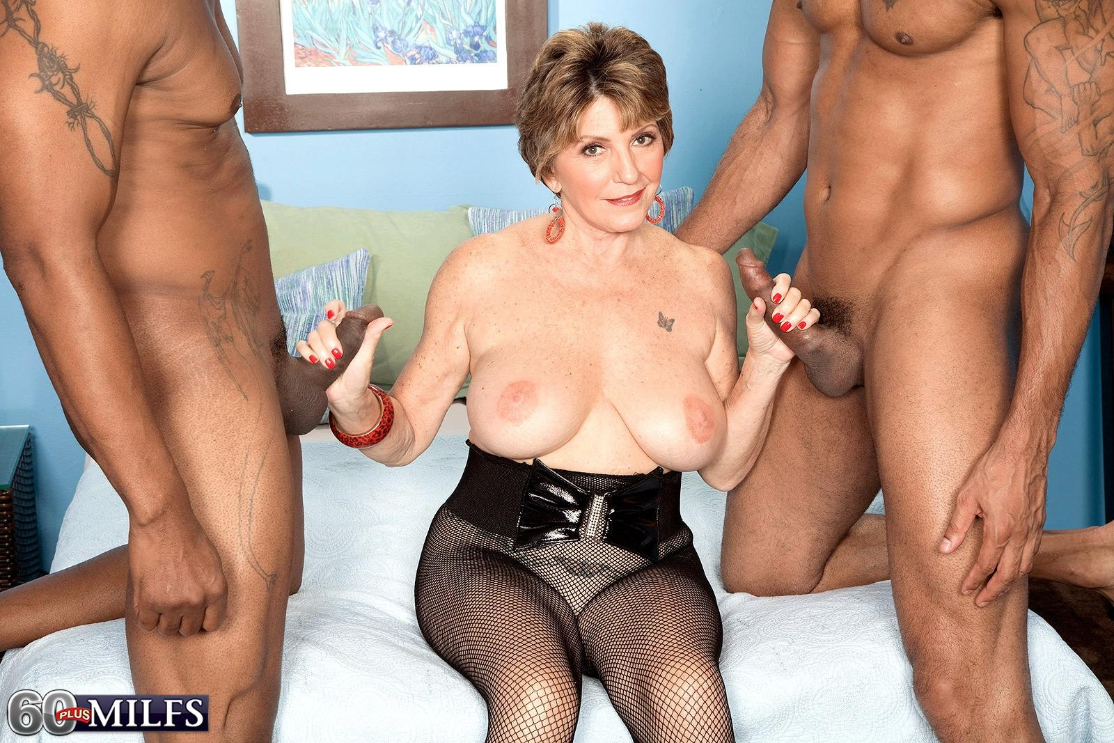 Busty 60 plus MILF Bea Cummins jerking BBC in interracial three way sex fest