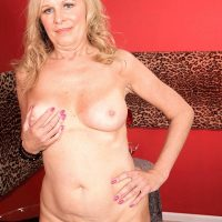 Busty blonde mature woman Bethany James flashing big tits and upskirt panties