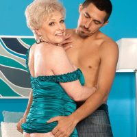 Busty granny Jewel having bare ass and pussy licked by younger man
