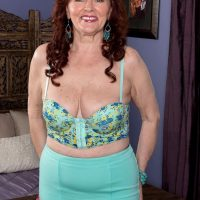 Busty redhead MILF over 60 Katherine Merlot giving big cock titjob in nylons