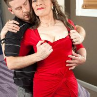 Pantyhose and high heel adorned granny Mona readying for sex with younger man