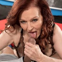 Redheaded 60 plus MILF escort Katherine Merlot giving big cock handjob and bj