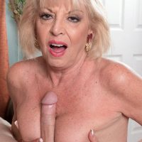 Stocking attired blonde MILF over 60 Scarlet Andrews tit fucking large cock