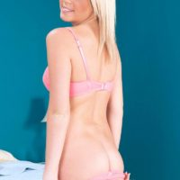 Blonde babe Alexis Adams freeing small teen tits and ass from lingerie and shorts