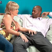 Blonde granny Lexi McCain freeing large tits before giving BBC oral sex