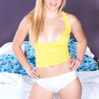 Blonde teen Tiffany Watson showing off ass in panties before baring small tits