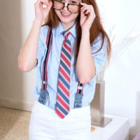Glasses wearing schoolgirl Alice Green baring tiny teen tits in panties