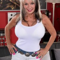 Leggy 60 plus MILF Sally D'Angelo revealing large mature tits before jerking cock