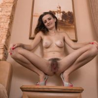 Leggy European amateur Ira fondling big natural tits while spreading hairy pussy