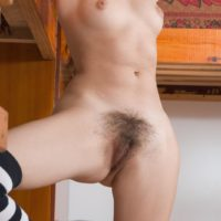 Long socks adorned amateur Vilma displaying nice tits and hairy pussy