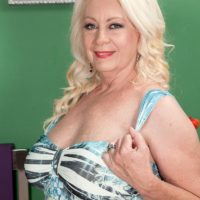 Plump blonde MILF over 60 Angelique DuBois baring pierced nipples and large tits