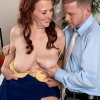Redhead granny Katherine Merlot revealing large saggy mature tits before oral sex