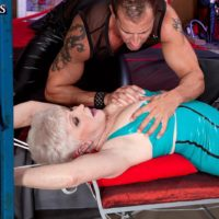 Short haired granny Jewel enjoying hardcore BDSM sex in latex dress and nylons