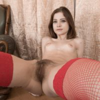 Tattooed amateur Emanuelle displaying hairy pussy in stockings and high heels
