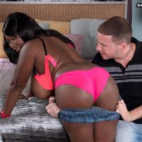 Black babe Marie Leone freeing massive boobs from lingerie in denim shorts