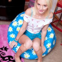 Blonde babe Sammy Daniels sliding shorts over ass and legs to reveal underwear