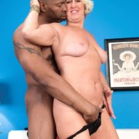 Blonde grandma Jeannie Lou giving big black cock interracial blowjob in lingerie