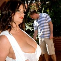 Brunette babe Maria Moore unveiling massive hooters outdoors in shorts