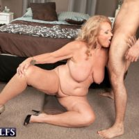 Busty blonde granny giving blowjob on knees before hardcore doggystyle sex