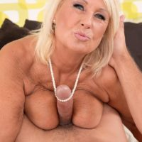 Busty blonde granny in stockings and lingerie giving big cock titjob and blowjob