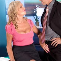 Busty blonde MILF over 60 Bethany James giving big cock blowjob in office
