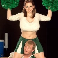 Cheerleader uniform attired Christy Marks loosing massive tits for tit fucking