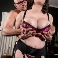 Chubby stocking and lingerie attired brunette Alana Lace having big tits exposed