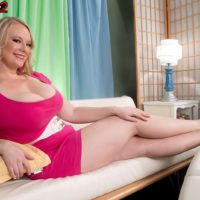 Curvy blonde babe Cameron Skye freeing massive juggs from dress for oiling