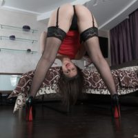 European brunette amateur Dea Ishtar spreading hairy pussy in stockings and heels