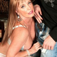 Hot MILF over 60 Lexi McCain seducing younger man in white stockings and lingerie