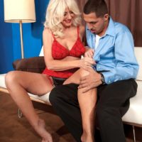 Leggy blonde granny Summeran Winters having large natural tits freed from bra