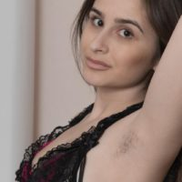 Leggy Euro amateur Penelope Fiore showing off furry armpits and spread beaver