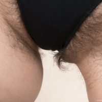 Leggy European first timer Slava Sanina displaying hairy cunt in black nylons