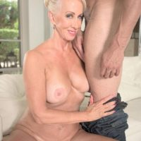 Mature blonde pornstar Madison Milstar baring large tits and upskirt underwear