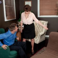 Over 60 MILF Bea Cummins letting large natural tits fall loose in skirt and high heels