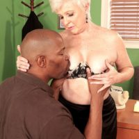 Over 60 MILF revealing large granny tits before interracial sex in office with BBC