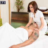 Petite Asian granny Kim Anh giving large cock handjob and BJ during massage