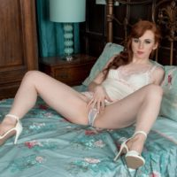 Redhead babe Vivi St. Claire releasing hairy ginger pussy from sexy lingerie