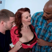 Redheaded granny Katherine Merlot baring big butt before interracial MMF 3some