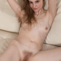 Small boobed amateur stripping off lingerie before exposing hairy vagina