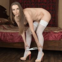 Stocking and high heel adorned brunette amateur spreading hairy pussy