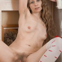 Stocking and lingerie attired European amateur revealing hairy pussy