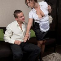 Stocking and uniformed adorned maid having large natural tits exposed for nipple play