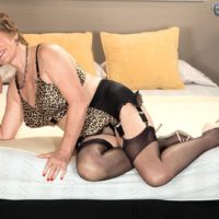 Stocking clad grandma Bea Cummins giving BBC handjob in high heels and girdle