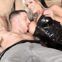 Stripper boot and latex clad mature pornstar Sally D'Angelo jerking and licking big cock