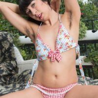Brunette solo girl Vivi Marie displaying hairy armpits and spread beaver outdoors