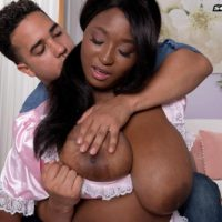 Chubby black girl Marie Leone freeing huge juggs from maid uniform for nipple licking