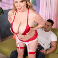 Chubby blonde pornstar Desiree revealing big boobs and giving BJ in stockings