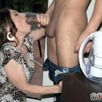 Clothed grandmother Mona seducing younger man by giving his big dick oral sex